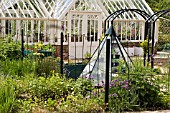 VIEW OF METAL AND PYRAMIDAL,   GREENHOUSE LEADING TO VEGETABLE AREA AT RYTON ORGANIC GARDEN,  MAY