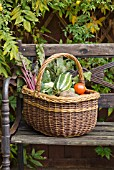 WICKER BASKET OF VEGETABLES CONTAINING MARROW, TOMATOES, CAULIFLOWER, BEETROOT AND POTATOES