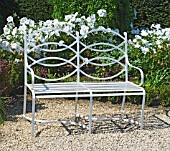 WHITE BENCH SEAT, WITH LAVATERA (WHITE SATIN), MERRIMENTS GARDENS, SUSSEX.