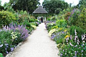 SUMMER HOUSE AND HERBACEOUS BORDERS, WEST DEAN GARDENS, SUSSEX.