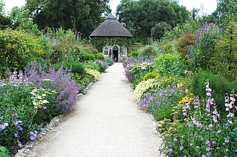 SUMMER_HOUSE_AND_HERBACEOUS_BORDERS_WEST_DEAN_GARDENS_SUSSEX
