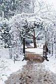 THE ENTRANCE ARCHWAY  TO NYMANS GARDENS, COVERED IN SNOW, SUSSEX.