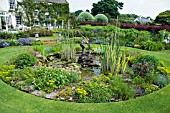 THE MAIN POND AND AQUATIC GARDEN AT THE HOUSE OF PITMUIES GARDEN, SCOTLAND. (Editorial use only)