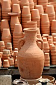 TERRACOTTA AMPHORA AND POTS ON DISPLAY AT A MARKET IN LEBANON