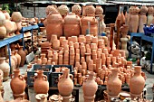 STACKS OF TERRACOTTA POTS ON DISPLAY AT A MARKET STALL IN LEBANON