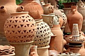 TERRACOTTA POTS AND JARS ON DISPLAY AT A MARKET STALL IN LEBANON