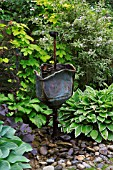 RUSTIC ROSE WATER FEATURE, ARTISANS COTTAGE GARDEN, BARNSDALE GARDENS