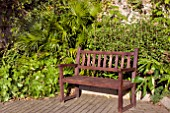 WOODEN BENCH IN A QUIET CORNER OF PENLEE MUSEUM GARDENS, PENZANCE