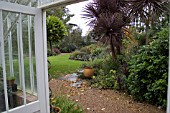 VIEW FROM CONSERVATORY DOOR INTO GARDEN AT DENMANS