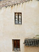 OLD WOODEN SHUTTER & WINDOW FRAME ON RUSTIC HOUSE IN ZARRA,  VALENCIA,  SPAIN.