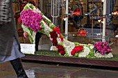 SLOANE IN BLOOM COMPETITION WINNER,  PLEASE KEEP OFF THE GRASS  LK BENNETT SHOE SHOP. FLORAL DISPLAY OF SHOES KINGS ROAD CHELSEA LONDON.CLIFTON NURSERIES