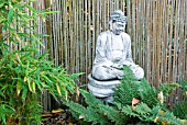 FERNS AND BAMBOO WITH BUDDHA STATUE