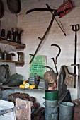 COLLECTION OF OLD GARDEN TOOLS AND AGRICULTURAL IMPLEMENTS.  DISPLAY AT WEST DEAN