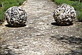 GARDEN ORNAMENTS IN THE FORM OF 2 ROUND BALLS MADE OF DRIFTWOOD FRAGMENTS