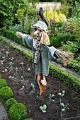 BARNSLEY HOUSE GARDENS, THE POTAGER WITH SCARECROW