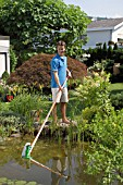 USING TELESCOPIC POND VACUUM