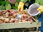 ADDING COMPOST ACTIVATER