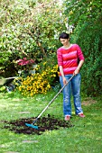 LAWN CARE - SPREADING SOIL AND SEEDS