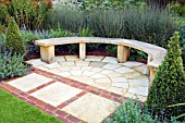 PAVED AREA WITH CURVED WOODEN BENCH