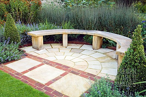 PAVED_AREA_WITH_CURVED_WOODEN_BENCH