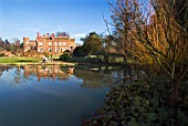 THE LAKE AND GARDENS AT HODSOCK PRIORY IN LATE WINTER