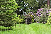 RUSTIC SUMMERHOUSE IN THE RIVERSIDE GARDEN AT PITMUIES HOUSE. FORFARSHIRE, SCOTLAND