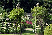FRONT GARDEN WITH GATES, LONICERA AND LILLIUM REGAL AT WOLLERTON OLD HALL