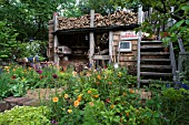A TRUGMAKERS GARDEN BY SERENA FREMANTLE AND TINA VALLIS AT RHS CHELSEA