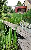 SWIMMING POND WITH WOODEN DECKING AREA