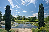 RHS GARDEN HYDE HALL. THIS IS THE VIEW FROM THE TOP POND TOWARDS THE HILLTOP GARDEN