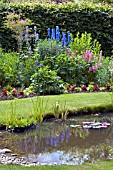 A COTTAGE GARDEN STYLE BORDER AND POND