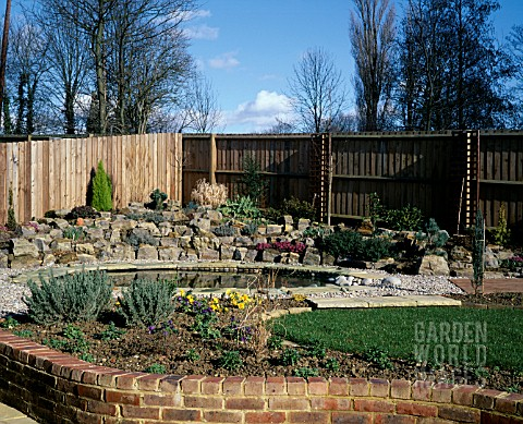 NEW_GARDEN_IN_DEVELOPMENT_1_FEBRUARY_WINTER_VIEW_ACROSS_THE_GARDEN_TO_POND_AND_ROCKERY