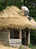 THATCHING SUMMERHOUSE AT WEST DEAN GARDENS